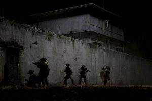 """FILE - This undated publicity film image provided by Columbia Pictures Industries, Inc. shows elite Navy SEALs raiding Osama Bin Laden's compound in the dark night in Columbia Pictures' gripping new thriller directed by Kathryn Bigelow, """"Zero Dark Thirty."""" (AP Photo/Columbia Pictures Industries, Inc., Jonathan Olley, File)"""